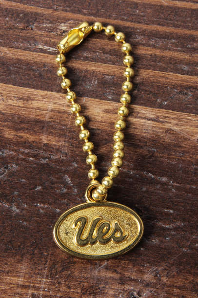 UES Original Brass Charm
